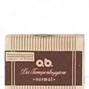 Imagem de uma versão antiga das embalagens de Tampões o.b.®. É amarela e castanha, com listas.